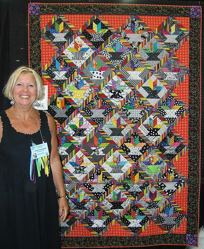 Linda Kuhlman and her quilt at NQA 2007