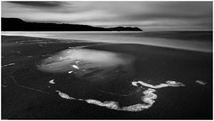 Southeast Cape V (nig gyl) Tags: fujifilmxt1 xf14mmf28r fujifilm fujinon xf14mm southwestwildernessnationalpark southcapebay southcoasttrack tasmania monochrome blackandwhite bw wideangle fuji southcaperivulet southernocean rocks beach ocean cloud sky sea cloudsstormssunsetssunrises therebeastormabrewin
