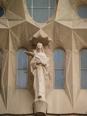 Statue along the Nave (rodtect) Tags: barcelona sculpture church architecture spain christ basilica religion puzzle gaudi catalunya lasagradafamilia passionfacade cataluna