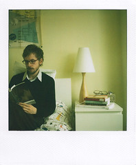 sunday morning (islets) Tags: portrait polaroid reading bedroom interior books ndfilter newscanner 600film sx70sonaronestep