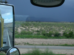Racing a storm. (Fluttergirl) Tags: sky cloud tractor storm west girl weather clouds truck mirror big highway driving skies texas semi rig driver wheeler thunderstorm trucks trailer 18 storms suzie semitruck peterbilt severe thunderstorms 18wheeler severeweather flutter truckdriver bigrig texasthunderstorm fluttergirl texasthunderstorms