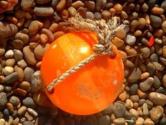 Bright buoy (philwirks) Tags: orange beach public devon myfavs prismatic luminosity philrichards cooliris flickrduel show08 flickrinfullcolor unlimitedphotos
