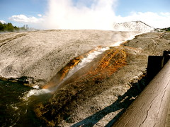 Excelsior Geyser runoff into Firehole River (Scorpions and Centaurs) Tags: blue usa hot nature water river vent yellowstonenationalpark wyoming geyser hotspring bacteria caliente boiling sulphuric sulphurous fireholeriver midwaygeyserbasin excelsiorgeyser