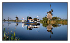 Kinderdijk, the Netherlands (fatboyke (Luc)) Tags: travel blue autumn sky holland reflection fall water reflections landscape ilovenature october europe paradise seasons postcard sightseeing nederland thenetherlands windmills tourist unescoworldheritagesite reflected nl boattrip miracles reflexions idyllic soe breathtaking kinderdijk attraction 2007 daydreams molinodeviento 333views supershot amazingshot abigfave excellentphotographerawards thegoldenmermaid childsdike alblasserwaardpolder 100commentgroup leuropepittoresque