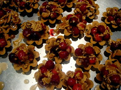 mini tarts with cranberries, sliced almonds, caramel drizzle (jblubird) Tags: cookies cake dessert cupcake tarts confections howsweetitis bakesgoods