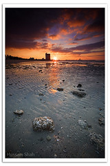 Dramatic Sunset (Hussain Shah.) Tags: city sunset sky beach clouds d50 nikon rocks dramatic sigma kuwait 1020mm hdr kuwaiti shuwaikh shah hussain abigfave superaplus aplusphoto superbmasterpiece muwali