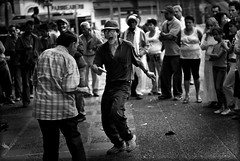 celo [zeal] (ladyinpink) Tags: life parque light blackandwhite man hat square dance colombia entertainer cinematography medellin celo happenstance zeal