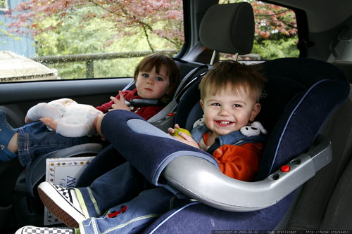 Toddlers Car Seat Secured In Middle Of Back Seat