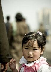 Young girl in Pyongyang (Eric Lafforgue) Tags: pictures travel woman girl female del asian photo women war asia republic femme picture korea il kimjongil korean socialist asie coree fille norte northkorea nk ideology axisofevil dictatorship  eastasia sung  corea dprk  april15 stalinist juche kimilsung 6016 lafforgue kimjungil  democraticpeoplesrepublicofkorea 15avril  ericlafforgue   coreadelnord   coreedusud dpkr northcorea juchesocialistrepubli
