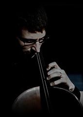 [ Eroi in penombra - Half-lighted heroes ] DSC_0610.2.jinkoll (jinkoll) Tags: portrait music musician cello glasses shadows classical playing fingers performer live chiaroscuro desaturation dark cellist baroque