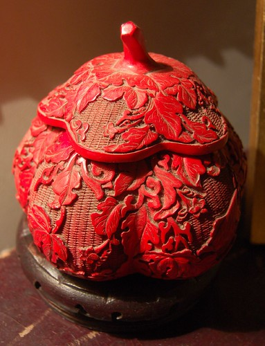 Pumpkin-shaped cinnabar container decorated with basket weave and leaves