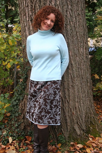 For fall: brown boots, new skirt, blue turtleneck, and a tree