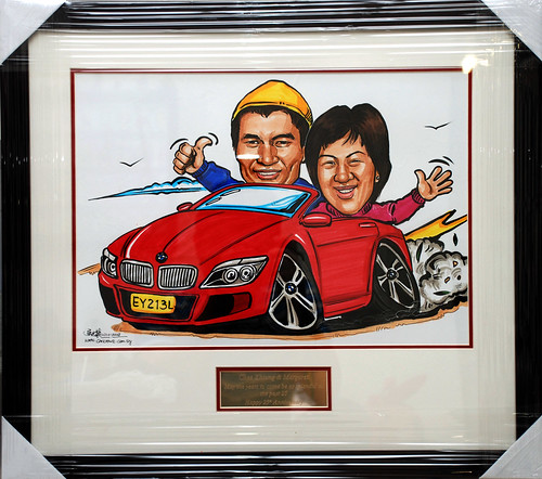 Caricatures couple BMW convertible framed with engraving
