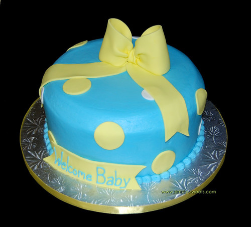 Baby boy shower cake blue with white and yellow polka dots