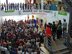 "The 'Stand up against poverty"" presentation, Oxford (allispossible.org.uk) Tags: poverty above uk england people white up stairs standing hair stand leute audience thomas political volunteers crowd unter under banner protest band voice menschen schultz listening staff oxford heads speaker gathering below underneath lookingdown director atrium campaign unten oxfordshire speaking oxfam global masses menge standup campaigns whiteband stehen congregate gcap standupagainstpoverty oxfamhouse oxfamers globalcampaignagainstpoverty thomasschultzjagow jagow"