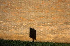 above the line (xgray) Tags: morning light shadow sunlight brick green grass sign wall digital upload canon austin eos texas dorm bricks iphoto 40d jestercenter efs1022mmf35
