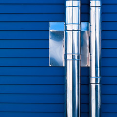 Two tubes (manganite) Tags: blue house abstract reflection geometric topf25 colors lines metal wall digital germany square geotagged topf50 nikon colorful europe tl pipes tubes minimal onecolor d200 minimalism nikkor dslr minimalistic thecolorblue 50mmf18 themoulinrouge herten northrhinewestphalia 500x500 utatafeature manganite nikonstunninggallery date:year=2008 geo:lat=51597144 geo:lon=7145436 date:month=march date:day=23 format:orientation=square format:ratio=11