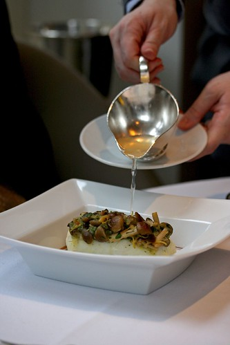 Pouring in the consommé; Halibut steamed with Honshimeji Mushrooms and Lemongrass Consommé
