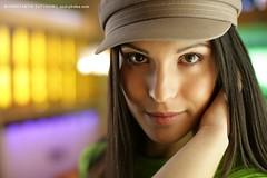 Vera (Konstantin Sutyagin) Tags: portrait woman color green girl beautiful face look hat eyes colorful looking head makeup vivid cap brunette cosmetics russian