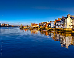 Whitby Harbour (Dave_O1 (so slowwww)) Tags: winter light sea lighthouse cold reflection abbey port canon boats pier harbour whitby whale stmaryschurch whitbyabbey blue sky river north sea yorkshire eos7d efs1585 whalesjawbones esk