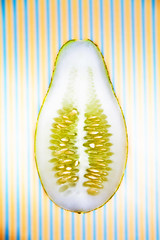 inside (Splat Worldwide) Tags: food canon studio eos saturated stripes cucumber floating vegetable 5d heirloom alienbees 1635mmf28l