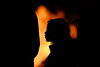 By firelight (Mark Rutter) Tags: silhouette fire profile firelight silhouetteonorange