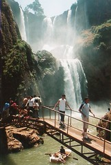 Cascades d'Ouzoud waterfall, Morocco (chris.bryant) Tags: bridge summer sky people sun nature water swimming river landscape waterfall day afternoon morocco flowing height movingwater cascadesdouzoud