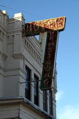 sun on hotel armstrong neon sign