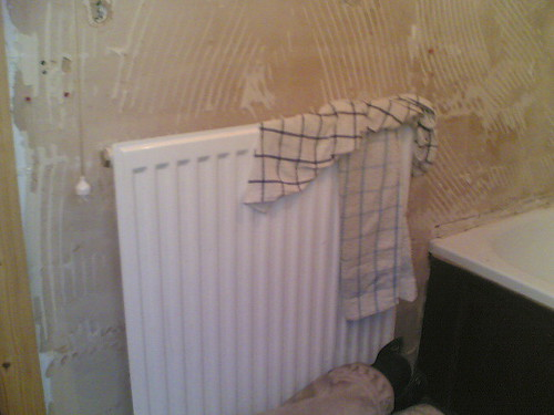 The radiator that WAS in the bathroom