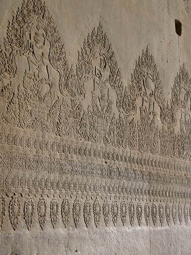 Carvings in the wall of Angkor Wat