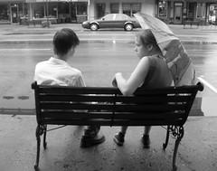 Unspoken, Unsettled (Jayneblonde) Tags: boy bw white black girl rain umbrella bench downtown romance relationship wetground goshen