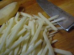 Cutting potato for french fries