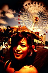Chatan, Okinawatropical girl (theCarol) Tags: travel summer vacation sky woman flower film girl japan lomo lca crossprocessed cross processing ferriswheel  okinawa   chatan      thecarol 200808 ctoe