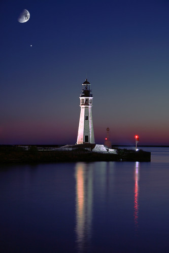 Lighthouse, the Buffalo Light, at Erie Basin Marina, Buffalo, NY Waterfront, sunset with moon and star in the sky