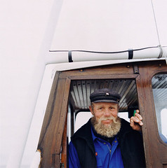 captain_photo.jpg (mhamberger) Tags: people men face smiling outdoors 1 fisherman eyecontact head beards cap boating vehicle males facialhair fishingboat laborer adults watercraft confidence headandshoulders headgear facialexpression middleaged middleagedman occupationsandwork babyboomers 50sadult shipcaptain