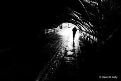 Tunnel Vision (Dave G Kelly) Tags: ireland light bw dublin man black silhouette dark tunnel minimal cobblestones negativespace minimalism cobbles sigma1020mm sigma1020 sigma1020mmf456exdchsm 123bw flimnoir aplusphoto bestofbw davegkelly