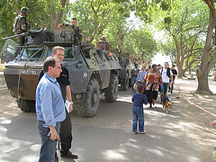 Military convoy escorting humanitarian workers and hotel guests