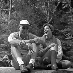 090358 07 00G (ndpa / s. lundeen, archivist) Tags: blackandwhite bw woman man 6x6 tlr film monochrome sunglasses laughing mediumformat river relax blackwhite couple nick young relaxing newhampshire whitemountains nh september 1950s laugh 1958 laughter shorts saco banks campingtrip dewolf crawfordnotch aviatorsunglasses sacoriver hikingtrip nickdewolf photographbynickdewolf