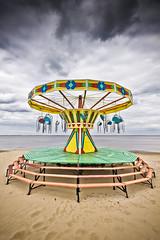 Hanging around... (Jez Blake) Tags: sea sky beach clouds sand fair lincolnshire merrygoround cleethorpes