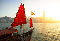 sailboat in Hong Kong harbor (leungchopan) Tags: china travel blue sunset red sky people white mountain reflection building classic water glass sailboat skyscraper landscape island hongkong harbor boat wooden high junk asia downtown ship tour flag hill sightseeing chinese peak sunny vessel center victoria tourist hong kong mount transportation convention sail reflective mast rise navigate gettyimageshongkongmacauq2