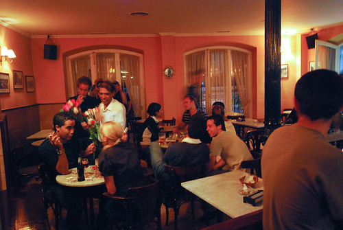 People eating in a dining room in Madrid and having a good time