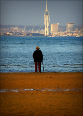 Over there (#1) The Spinnaker Tower from Appley sands (s0ulsurfing) Tags: ocean sunset sea people sun seascape blur beach water island evening coast twilight focus alone dof sundown bokeh dusk candid shoreline coastal shore vectis isleofwight portsmouth spinnakertower coastline lowtide isle humans wight 2007 ryde appley s0ulsurfing coastuk appleysands welcomeuk