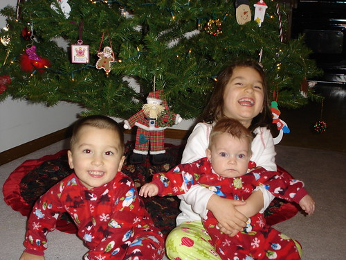 Christmas pjs by the tree