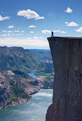 Preikestolen (Pulpit Rock) (Jim Boud) Tags: ocean sky cliff mountain norway clouds digital canon eos rebel interestingness hike atlantic explore fjord hdr xsi topaz preikestolen prekestolen lysefjorden norse adjust pulpitrock explored bej 450d forsand anawesomeshot jimboud jrbxom jamesboud jamesboudphotoart gettyvacation2010