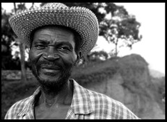 farmer in haiti (LindsayStark) Tags: travel portrait blackandwhite men haiti war conflict humanrights humanitarian humanitarianaid emergencyrelief waraffected