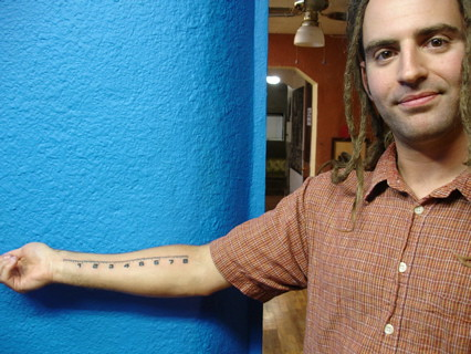 "8"" ruler tattoo'd to right forarm."