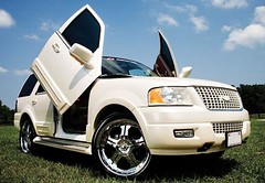 white Ford Expedition with lambo doors