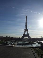 Eiffel Tower (cheesemonster) Tags: sun paris france lady de la frankreich iron ledefrance glare trails landmark toureiffel frankrijk dame francia rp fer    rgionparisienne parisregion theironlady ladamedefer  afeatofengineering