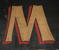 Letter M (Silver Spring, MD) (takomabibelot) Tags: red black yellow geotagged gold maryland m cobweb letter mm silverspring oneletter 961 majuscule bonifantstreet jimdandycleaners geo:lat=3899357 geo:lon=77026002