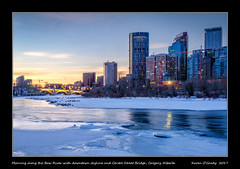 Morning along the Bow River with downtown skyline and Centre Street Bridge, Calgary Alberta [EXPLORED] (kgogrady) Tags: bowriver centrestreetbridge downtown landscape winter calgary alberta canada canadiancity 2017 clouds buildings calgaryphotos cityscape fujifilmxt2 bluehour albertalandscapes bridge fujinon calgarypictures city ab frozen fujifilm trees westerncanada yyc water xt2 xf18135mmf3556oiswr morning nopeople noone flowingwater ice skylinephotos skyscrapers river skylinepictures explored